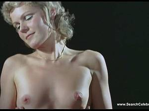Blonde cutie Ursula Marty showing her tits to the world