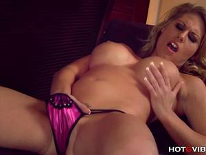 Classy Charisma uses her new toy to rub her pussy